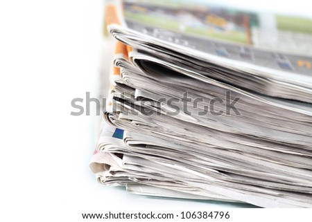 Old newspapers pile up - stock photo