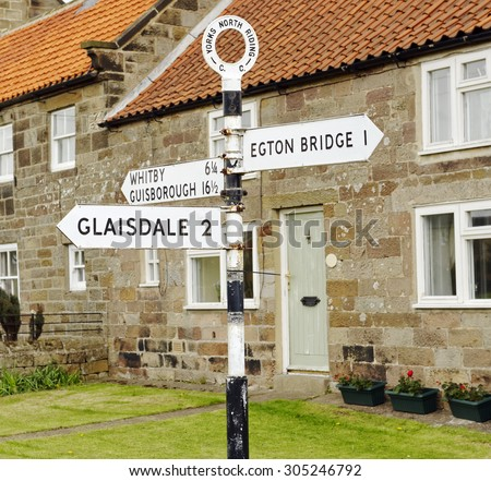 Old North Riding county road sign in the village of Egton in North Yorkshire, England - stock photo