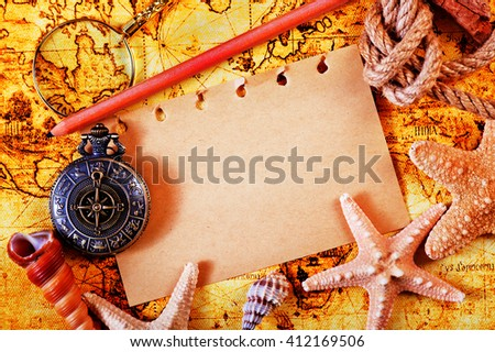 old notebook, loupe and compass on the map - stock photo