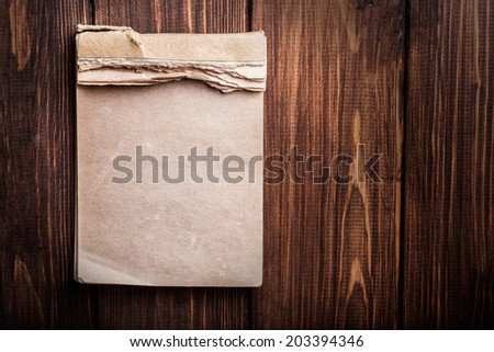 old notebook on wooden background - stock photo