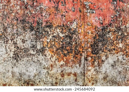 Old, obsolete, badly corroded river raft hut floater metal surface, covered with cracked decomposed layers of red paint, tar and rust. - stock photo