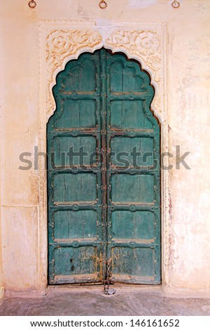 old obsolete wooden closed door in india - stock photo