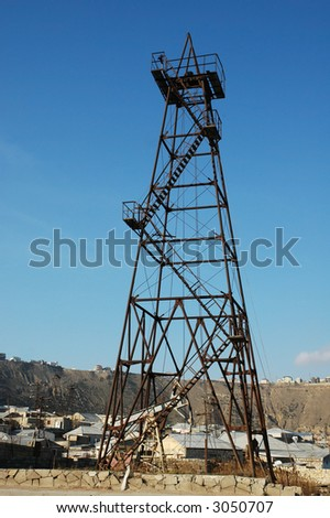 Old oil derrick  during bright summer day - stock photo