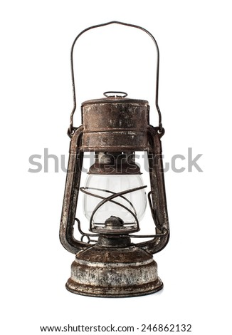 Old oil lamp isolated on white background - stock photo
