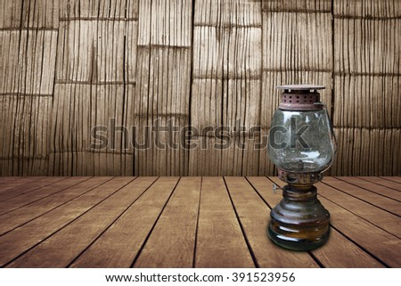 old oil lamp with old bamboo wall background