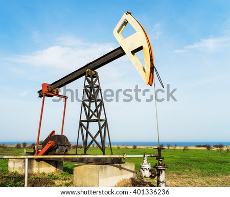 Old oil rig working on the Black Sea - stock photo
