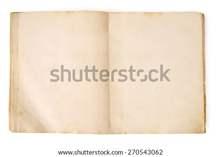 Old open book lies on the table on a white background