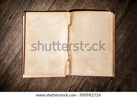 Old open book on table with pencil. - stock photo
