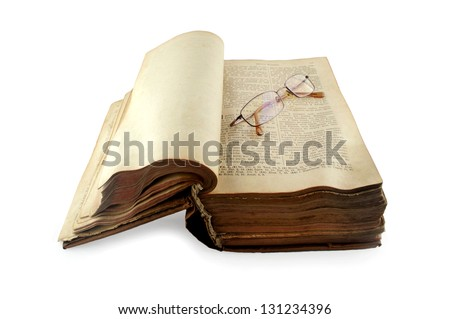 old open Russian bible with glasses isolated on white background - stock photo