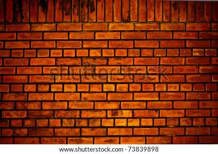 Old orange brick wall pattern texture - stock photo