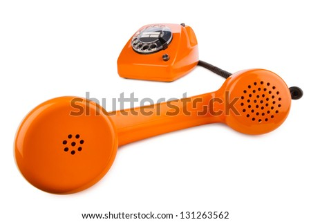 old orange retro phone with rotary dial - stock photo