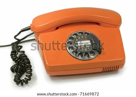 Old orange telephone  isolated on white background - stock photo