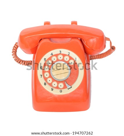 old orange telephone with rotary dial isolate on white
