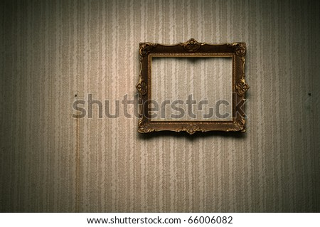 Old ornamented frame on retro grunge wall - stock photo