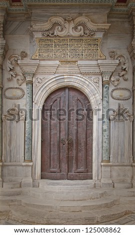 Old ornate wooden doors at a mosque in istanbul, Turkey.