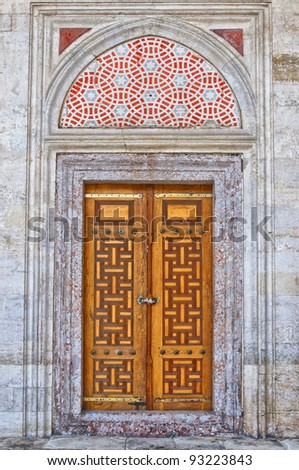 Old ornate wooden doors at the Sehzade mosque in istanbul, Turkey. - stock photo