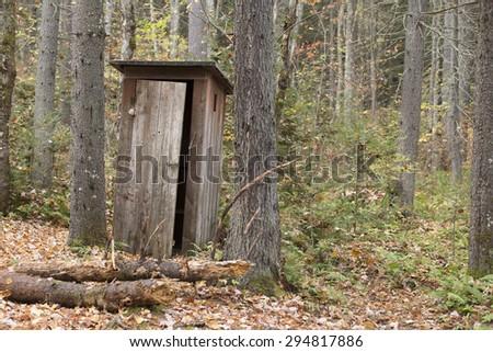 Old outhouse on adirondack Camp - stock photo