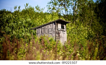 Old Outhouse Waiting For You - stock photo
