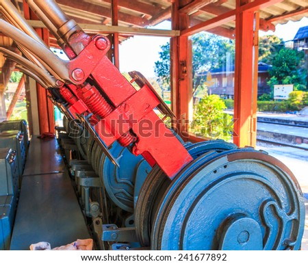 Old overgrown used railway track switch mechanism in artistic conversion - Equipment for the shunt - stock photo
