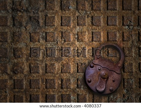 old padlock metallic sewer cover at the background - stock photo
