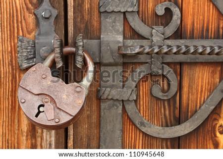 Old Padlock On Wooden Dooriron Lock Stock Photo 110945648