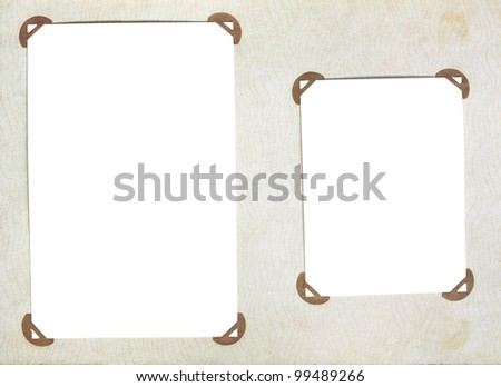 Old page of vintage photoalbum with photo frames - stock photo