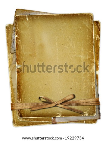 Old page with ribbons and bow on the isolated white background