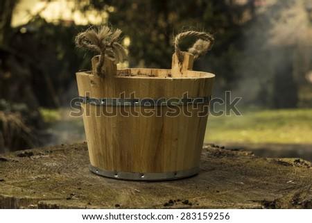 Old pail on the stump - stock photo