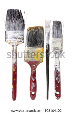 Old Paint Brushes on White Background - stock photo