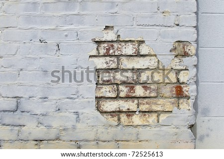 Old painted brick wall fragment - stock photo