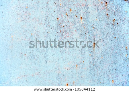 Old painted metal sheet with rust - stock photo
