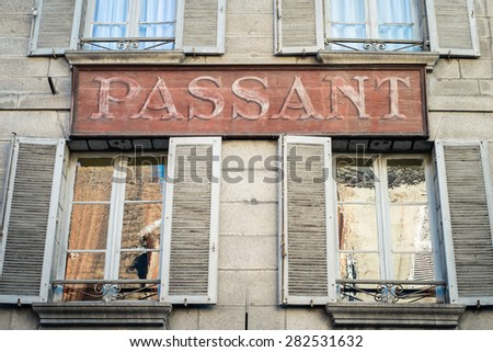 Old painted sign above store, Aubusson, La Creuse Department, Limousin, France