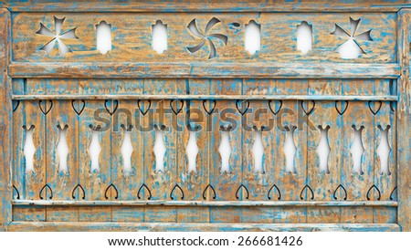 Old painted wood panel with abstract carving, balinese craft - stock photo