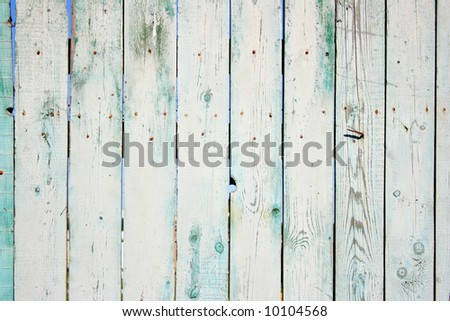 Old painted wooden fence close-up, may be used as background - stock photo