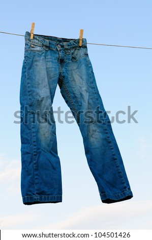 Old pair of blue jeans on a clothesline