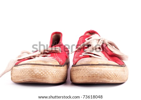 Old pair of red sneakers