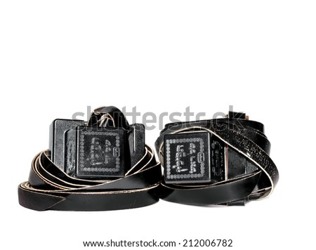 Old pair of tefillin. Worn by Jewish men during prayer. Embossed with Hebrew words and decorative design. Nice for a bar mitzvah theme. Room for text, copy space. Isolated on a white background.  - stock photo