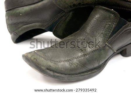 old pair of used shoes over white background - stock photo