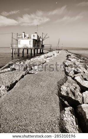 old palafitte on the sea - stock photo
