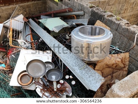 old pans and washing machine basket and rusty iron ore dump in waste landfill - stock photo