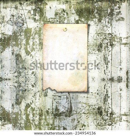 Old paper ad on shabby brick wall background - stock photo