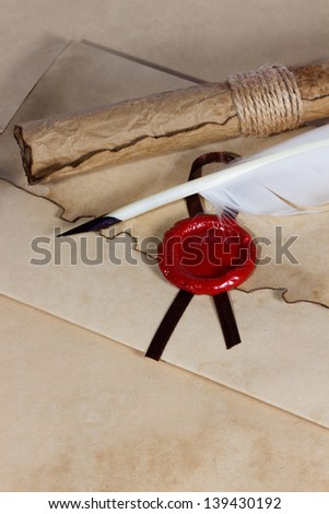 old paper, ancient parchment  scroll, envelope with wax seal and quill pen - stock photo