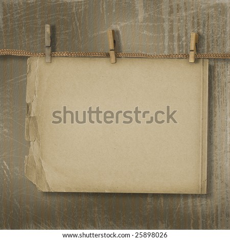 Old paper are hanging in the row on the striped background - stock photo