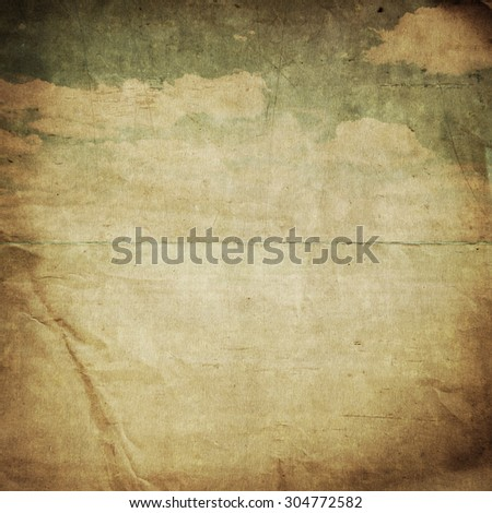 old paper background with delicate grunge texture and blue sky  - stock photo