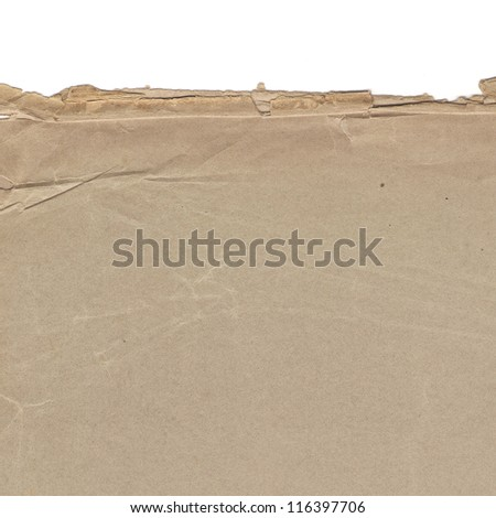 Old paper background with torn distressed edge - stock photo