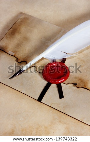 old paper, envelope of ancient parchment with wax seal and quill pen - stock photo
