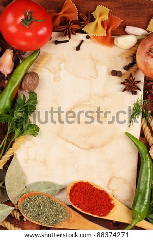 old paper for recipes and spices on wooden table - stock photo