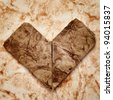 old paper heart on a textured paper background - stock photo