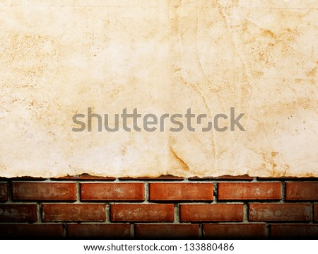 old paper on brick wall