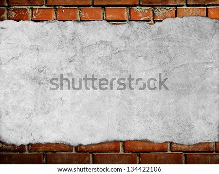 old paper on brick wall - stock photo